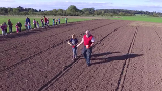 People on a field with seeds